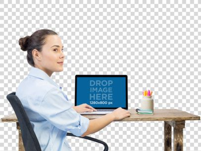 MacBook Mockup of a Beautiful Woman Working at Her Desk a11687
