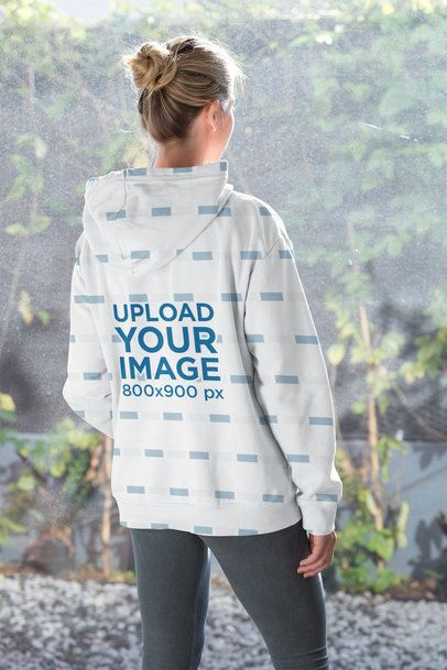 Sublimated Hoodie Mockup of a Woman Looking Through the Window 31249