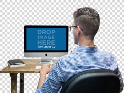 Mockup of a Man Working at His iMac 11729