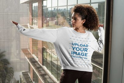 Mockup of a Woman with an Oversized Crewneck Sweatshirt Posing by a Window 31156