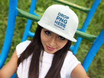 Hat Mockup Featuring a Smiling Hispanic Girl at a Park 11711