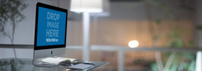 iMac Mockup on a Glass Desk in a Modern Office a11759