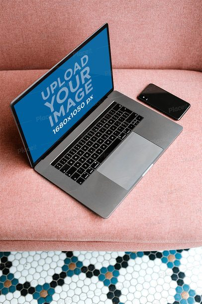 Mockup of a MacBook Next to a Phone on a Pink Sofa 2457-el1