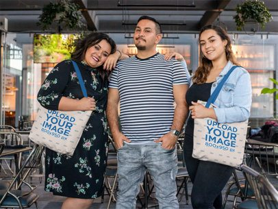 Tote Bag Mockup Featuring Two Women Posing with Their Friend 31079