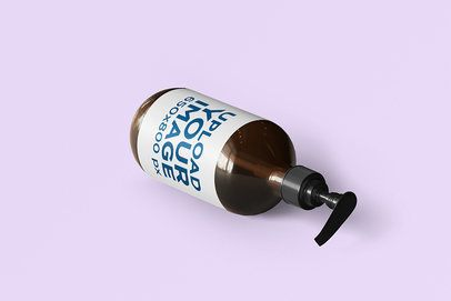Mockup Featuring a Dispenser Bottle Lying on a Solid Color Surface 2393-el1