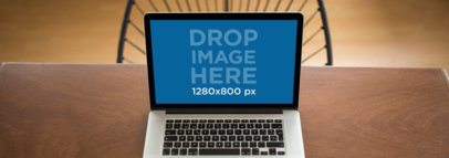 Wide Shot MacBook Mockup Over a Wooden Table a11786