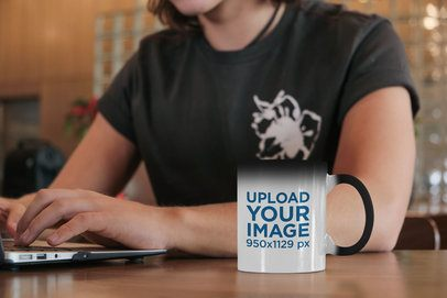 11 oz Magic Mug Mockup Featuring a Man Working 31594