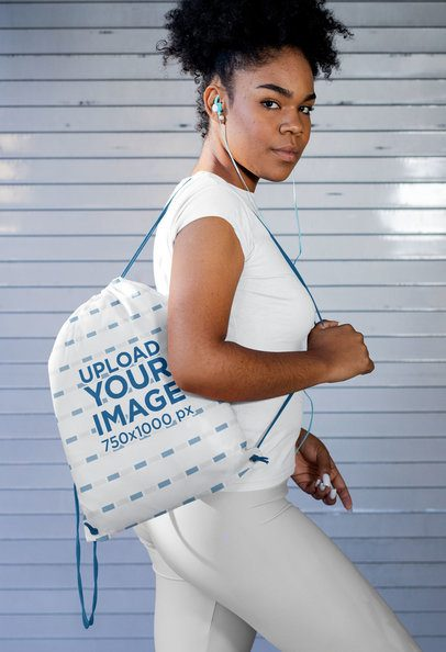 Mockup of a Fitness Woman Carrying a Drawstring Bag 31329