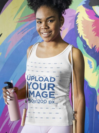Mockup of a Fitness Woman Wearing a Tank Top by a Mural Painting 31336