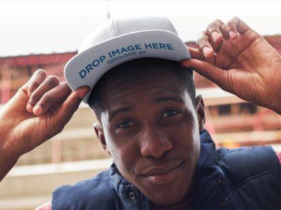 Urban Style Young Black Man Wearing a Snapback Mockup 11774