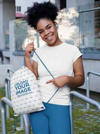 Mockup of a Woman Pointing at Her Drawstring Bag 31340