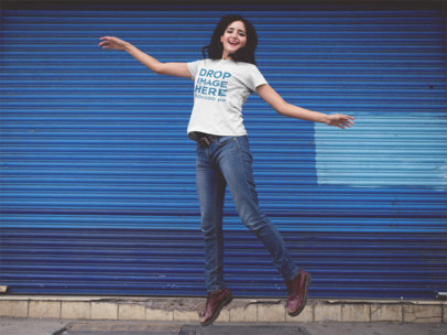 Round Neck Tee Mockup of a Girl Jumping in the Street a11823