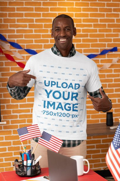 Mockup of a Man Pointing at His T-Shirt with a Political Slogan 31932