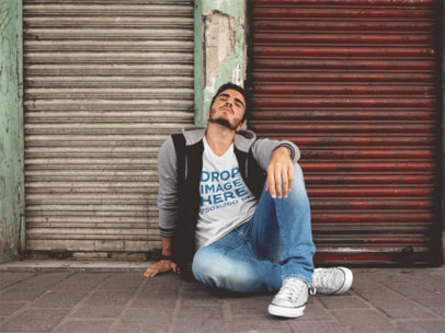 T-Shirt Mockup of a Guy Sitting With His Eyes Closed a11862