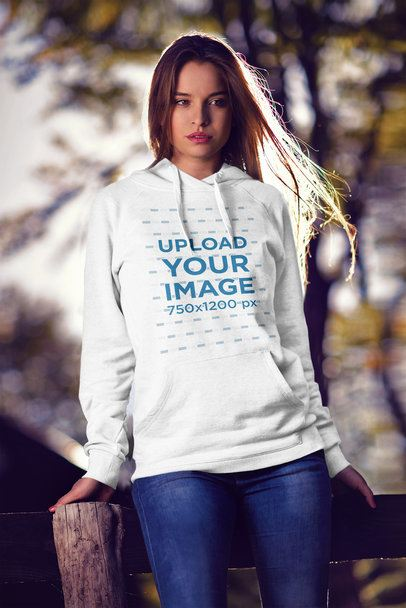 Pullover Hoodie Mockup of a Woman Leaning Against a Rustic Wooden Fence 2790-el1