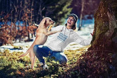 Hoodie Mockup of a Woman Playing with Her Dog in the Woods 2781-el1