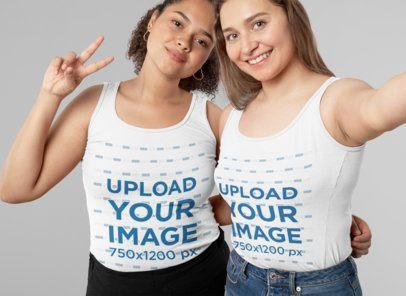 Studio Mockup Featuring Two Women Wearing Tank Tops Taking a Selfie 31990