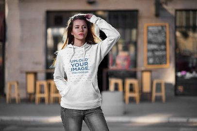 Mockup of a Long-Haired Woman Posing in the Street with a Pullover Hoodie 2784-el1
