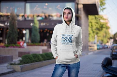Mockup of a Woman Wearing a Pullover Hoodie in the City 2787-el1
