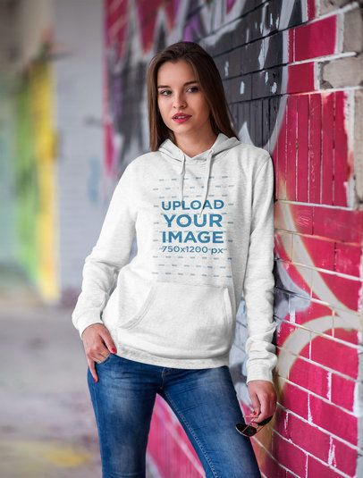 Mockup of a Woman Wearing a Pullover Hoodie Leaning Against a Graffiti Wall 2798-el1