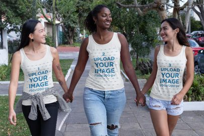 Tank Top Mockup of Three Women Walking Down the Street Holding Hands 32042
