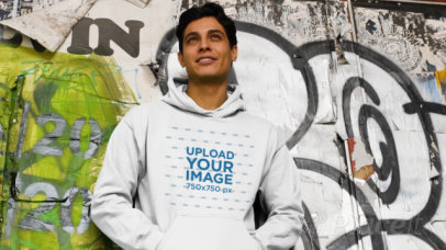 Video of a Man Wearing a Pullover Hoodie with a Graffiti Background 32022