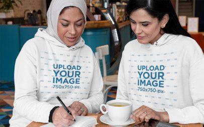 Pullover Hoodie Mockup Featuring Two Women Working Together at a Restaurant 32079