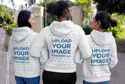 Hoodie Mockup of Three Women Walking Down the Street 32061
