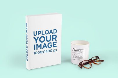 Paperback Book Mockup Featuring a Scented Candle and a Customizable Background 2896-el1