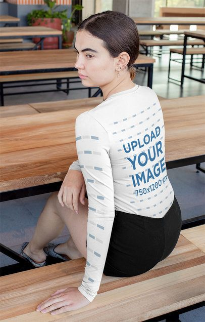 Long Sleeve T-Shirt Mockup of a Serious Woman Sitting at a Table 31469
