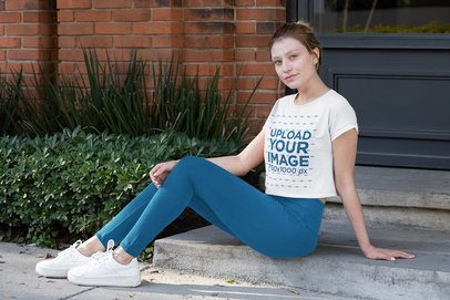 Crop Top Mockup Featuring a Young Woman Sitting on a Curb 31500