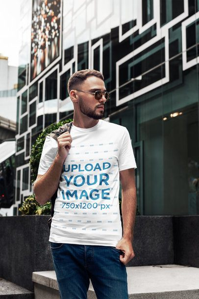 T-Shirt Mockup of a Bearded Man Posing Next to a Cool Building 2816-el1