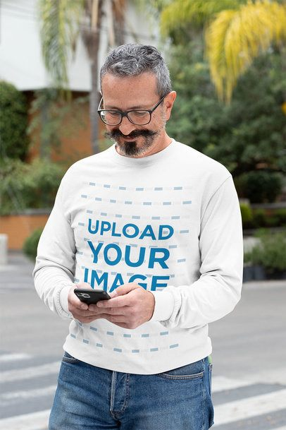 Long Sleeve Tee Mockup of a Man Texting with a Smile on His Face 31716