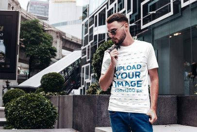 T-Shirt Mockup Featuring a Stylish Man in the City 2818-el1
