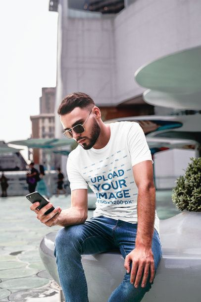 T-Shirt Mockup of a Cool Man Staring at His Phone in the City 2821-el1