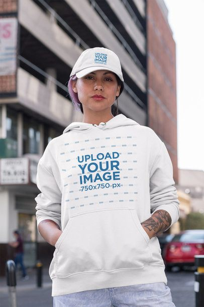 Hoodie Mockup of a Serious Woman Wearing a Dad Hat in the Street 31185
