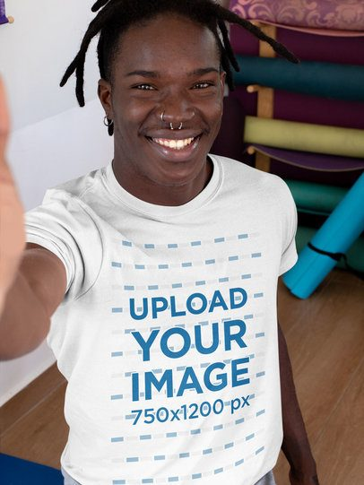 T-Shirt Mockup of a Man Taking a Selfie at a Yoga Studio 31107