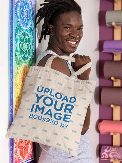 Tote Bag Mockup Featuring a Smiling Man in a Yoga Studio 31112