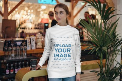 Sweatshirt Mockup of a Young Woman at a Marketplace 2839-el1