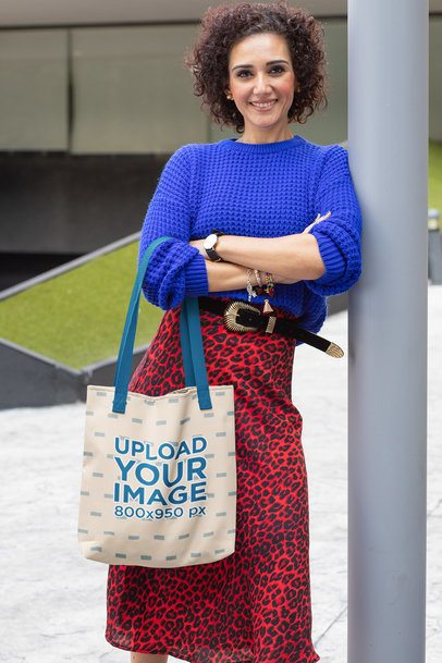 Tote Bag Mockup of a Middle-Aged Woman Leaning Against a Lamp Post 31622