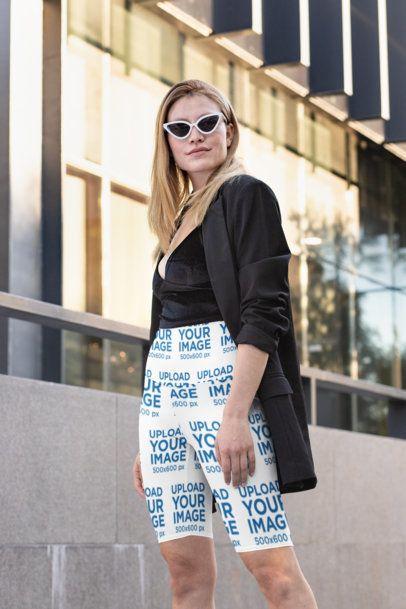 Bike Shorts Mockup of a Stylish Woman by a Modern Building 31508