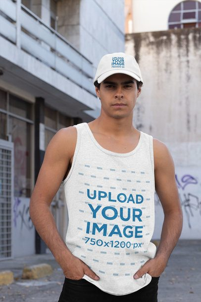 Tank Top and Dad Hat Mockup Featuring a Young Man in an Urban Scenario 31174