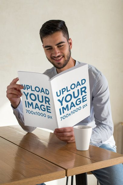 Mockup Featuring a Man Smiling While Reading a Magazine 31556