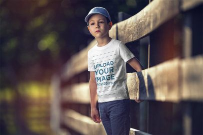 T-Shirt Mockup Featuring a Serious Boy by a Rustic Wooden Fence 2921-el1