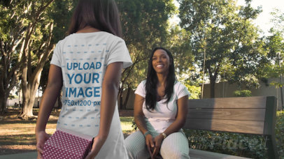T-Shirt Video Featuring a Girl Giving Her Mother a Present at a Park 32341