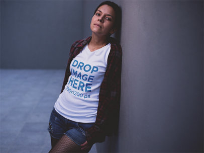 Mockup of an Alternative Style Girl Wearing a T-Shirt and Leaning Against a Wall a12226