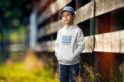 Hoodie Mockup of a Boy Standing by a Fence 2928-el1