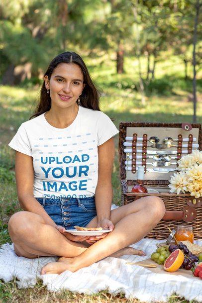 T-Shirt Mockup of a Woman Sitting by a Picnic Basket 32281