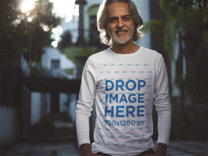 Long Sleeve T-Shirt Mockup of a Stylish Older Man in his House a12249