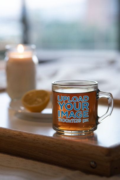 Mockup of a Glass Mug Placed Next to a Candle 31765